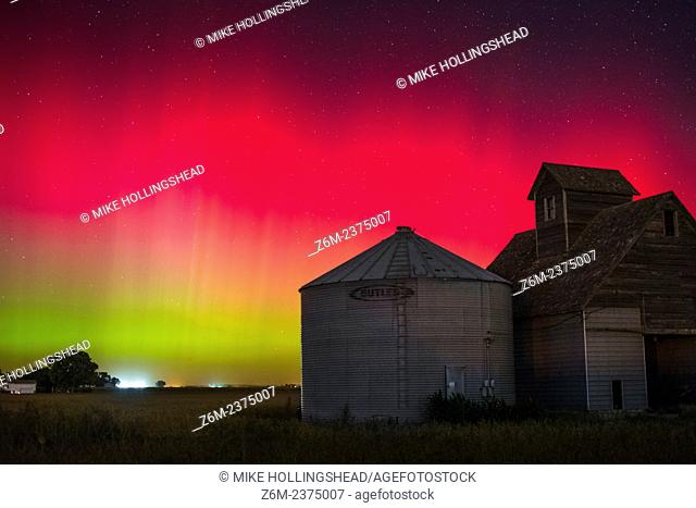 Bright red auroras dance over Iowa during a short but intense outburst of northern lights