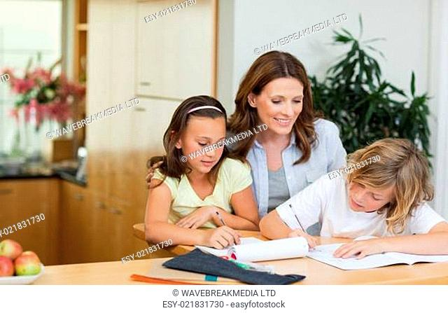 Mother having a look at children&#039 s homework