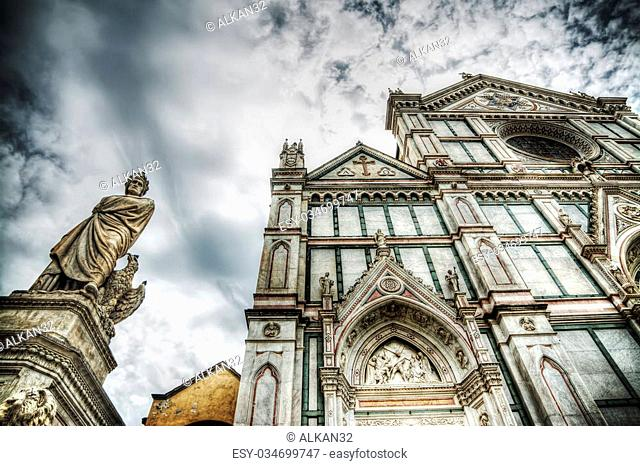 XIX century Dante Alighieri statue and Santa Croce cathedral in Florence, Italy