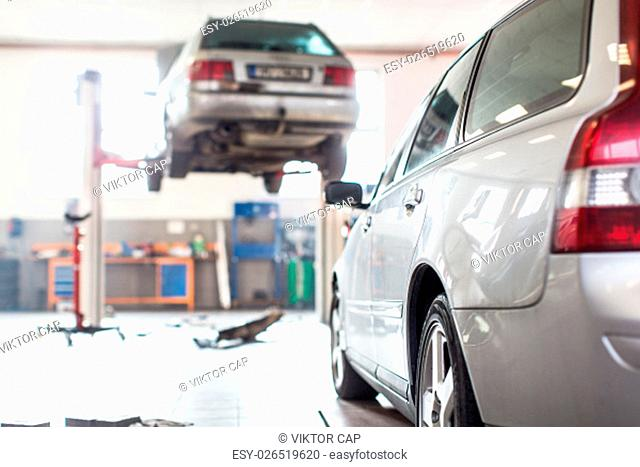 Cars in a garage (shallow DOF; color toned image)