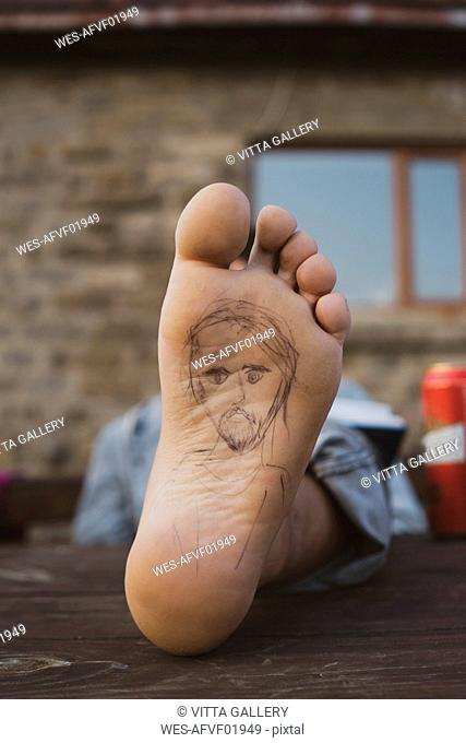 Sole of foot of an hiker during break, painted portrait