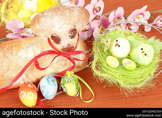 Easter lamb with painted eggs and nest