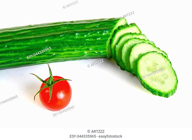 Red cherry tomatoes and green cucumber isolated on white background