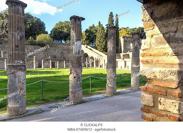 Arcade of Theaters or Gladiator Barracks in Ancient Pompei village, Naples district, Campania, Italy