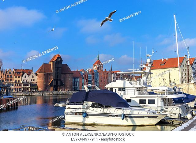 Yachts moored in the Motlawa in front of Zuraw Port Crane, Gdansk, Poland