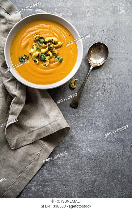 Pumpkin soup with cashews and herbs