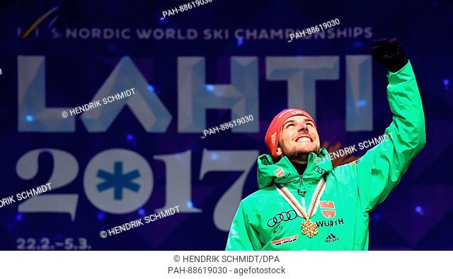 Johannes Rydzek from Germany celebrates his gold medal at the Nordic Ski World Championship in Lahti, Finland, 01 March 2017