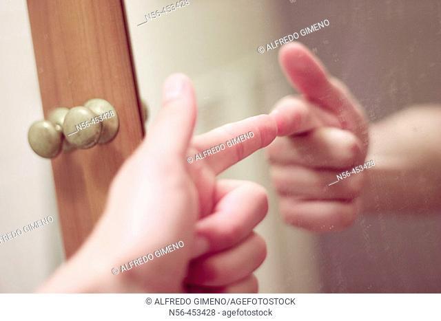 Mirror image of hand shooting
