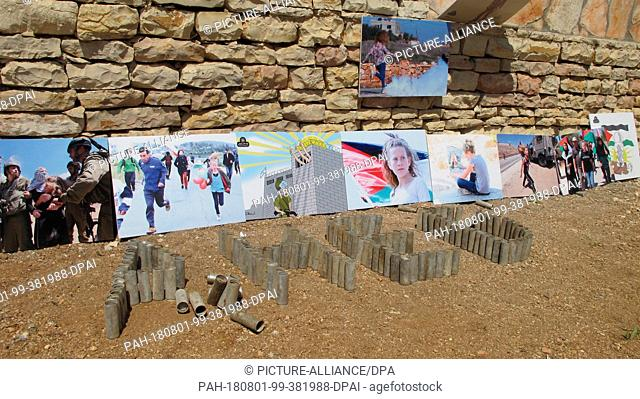 31 July 2018, West Bank, Nabi Saleh: Posters with pictures of Ahed Tamimi are placed in her family garden. In front of it