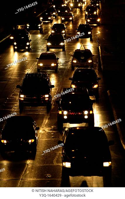 Vehicle traffic on a rainy night