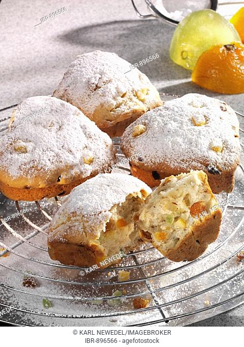 Heart-shaped Christmas Stollen with powder sugar on a baking rack