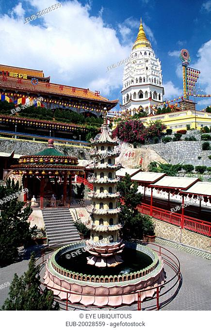 General view of temple complex with Ban Po, the Pagoda of a Thousand Buddhas in background and circular pond with seven tiered pagoda sculpture in centre in...