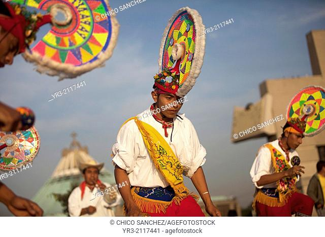 Totonacan indigenous teenage dancers from Papantla, Veracruz, perform the Dance of the Guaguas at the pilgrimage to Our Lady of Guadalupe Basilica in Mexico...
