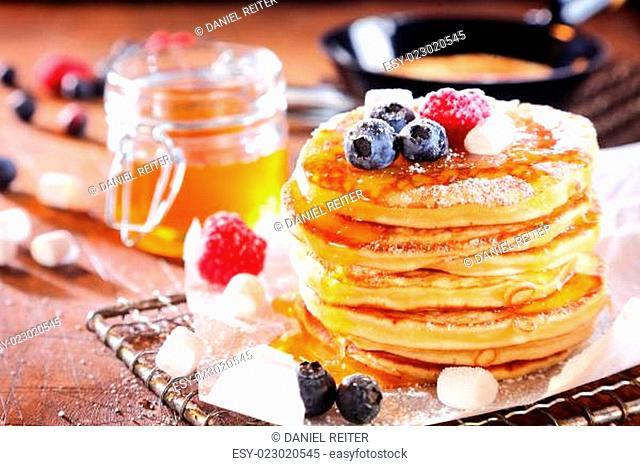 Stack of fresh golden pancakes or flapjacks