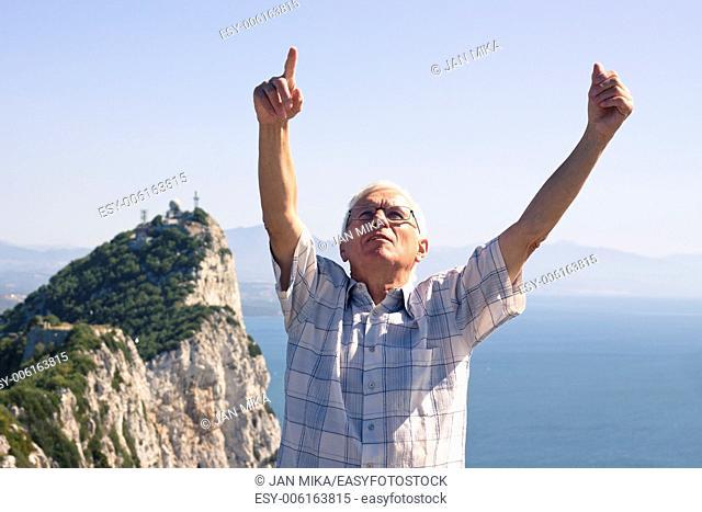 Portrait of happy senior man tourist at the Rock of Gibraltar