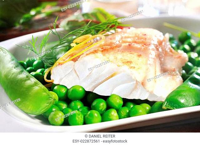 Healthy grilled fish steak with peas