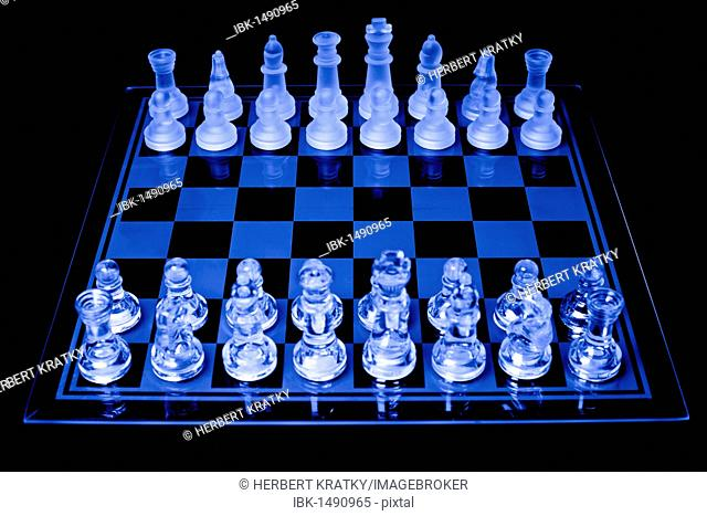 Chessboard with pieces made of glass