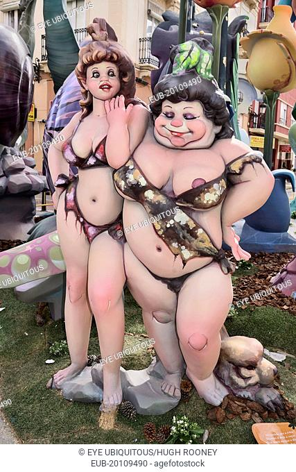 Two female Papier Mache figures in the street during Las Fallas festival