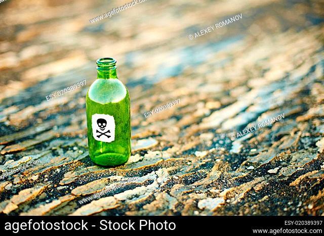 Green glass bottle from poison