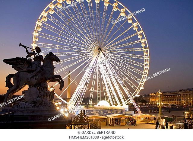 France, Paris, Place de la Concorde, one of the Marly Horses and the Great Wheel