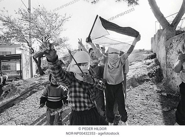 Children with covered faces and protesting in Israel