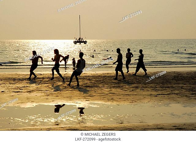 A group of men playing soccer on White Sand Beach, Hat Had Sai Khao, Koh Chang Island, National Park Mu Ko Chang, Trat, Gulf of Thailand, Thailand, Asia
