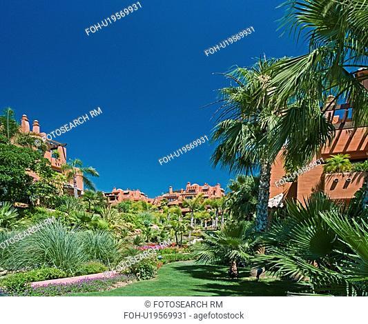 Palm trees in garden of newbuild Spanish holiday village