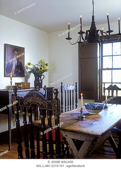 DINING ROOMS: Antiques, bannister back chairs, sawbuck table, tin chandelier, sideboard, vase of sunflowers, oil portrait , shutters, period colonial