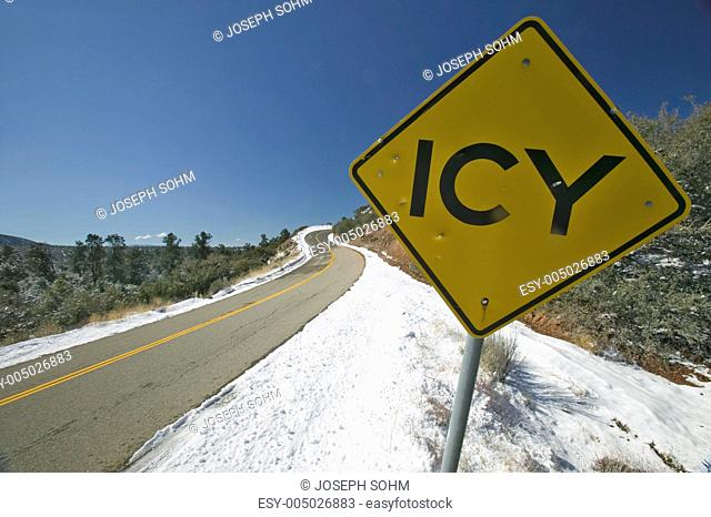 Icy Road sign after fresh snow near Pine Mountain Club, Kern County, Southern California