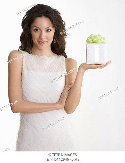 Woman in formal dress holding gift