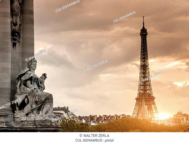 Sculpture on Pont Alexandre III bridge and Eiffel Tower, Paris, France