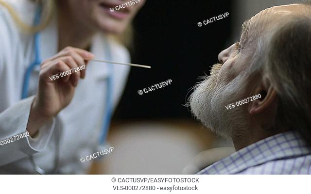 Doctor checking a patient's inflamed throat
