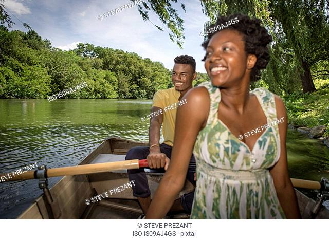 Young couple in rowing boat on lake in Central Park, New York City, USA
