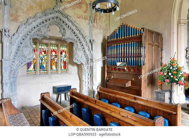 England, Essex, Belchamp Walter, A stained glass window and church organ inside St Mary the Virgin. The church is home to a number of outstanding medieval wall...