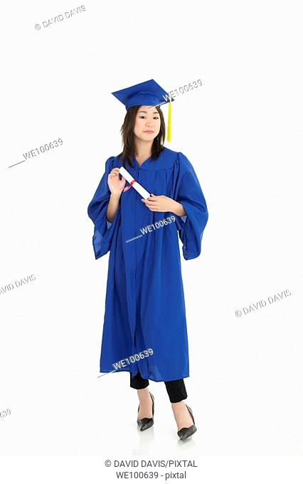 Asian teenage very excited about graduation on white background