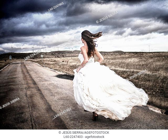 Bride running on the road