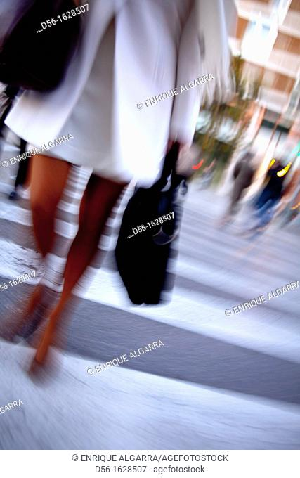 young woman crossing the street