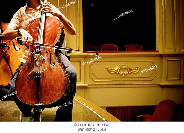 Closeup of a cellist rehearsing at the Teatro Principal de Mahon, Minorca, Balearic Islands, Spain