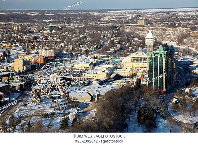 Niagara Falls, Ontario - The city of Niagara Falls, Ontario in winter. The Clifton Hill tourist entertainment district is in the foreground
