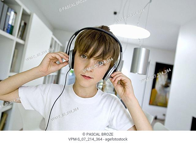 Portrait of a boy listening to music