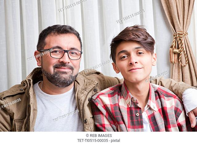 Portrait of father and teenage son