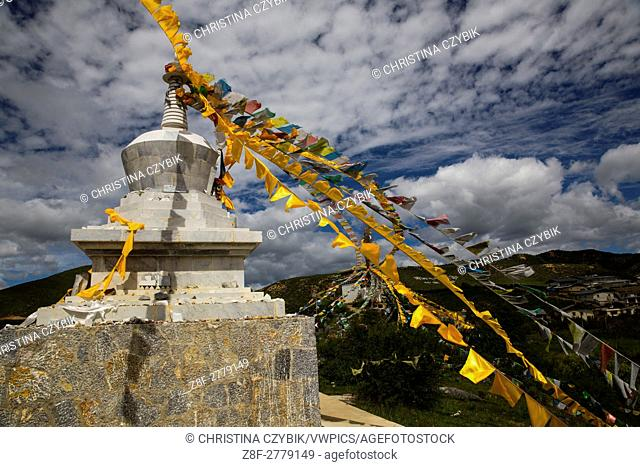 Prayer flags and the Stupa at the Ganden Sumtseling Monastery in Shangri La