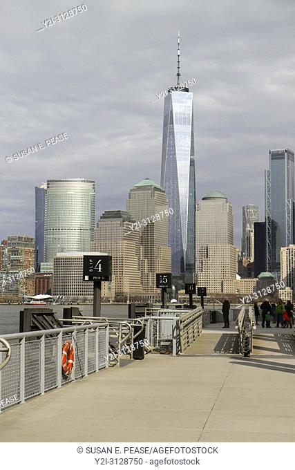 New York Waterway ferry terminal slips, Jersey City, New Jersey. One World Trade Center and other Lower Manhattan buildings seen from across the Hudson River