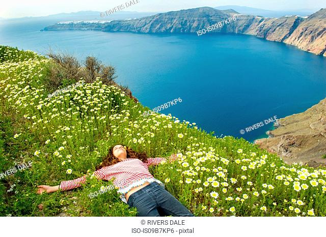 Girl asleep on bed of flowers, Oía, Santorini, Kikladhes, Greece