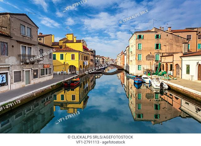 Europe, Italy, Veneto, Venice. Colorful houses of Chioggia reflected in the main canal