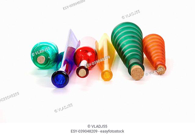 colored glass vases on a white background