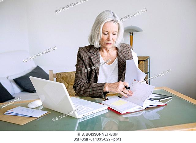 Elderly person teleworking