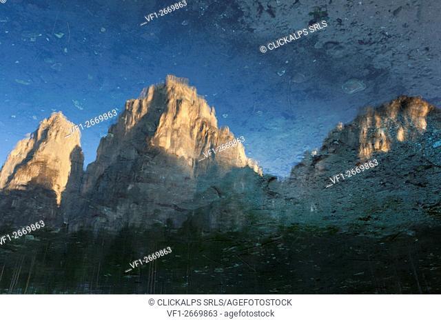 Pale di San Lucano, Reflection in small lake of the Peschiere, San Lucano valley, Taibon Agordino, Belluno, Dolomites