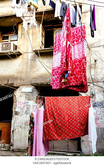 Chongqing, China - The view of famous old shanty town,Shibati,some people hanging the laundry out to dry