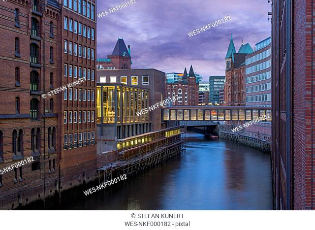 Germany, Hamburg, Old Warehouse District, Canal in the evening
